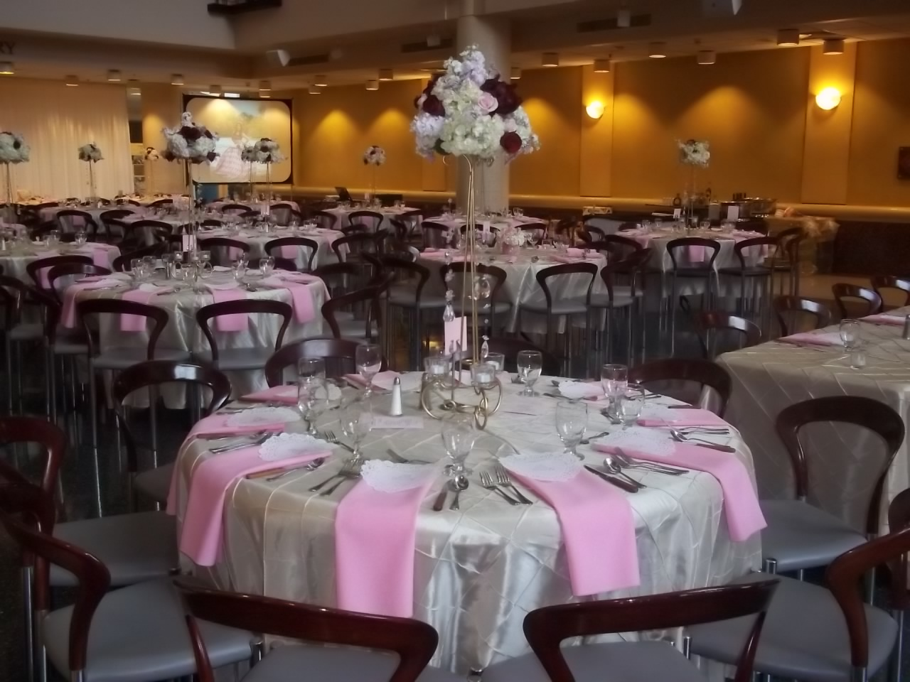 Pink Table Settings at Quinceañera put on by Hannibal's Catering
